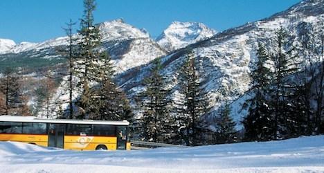 PostBus coach in Swiss mountains Photo: PostBus